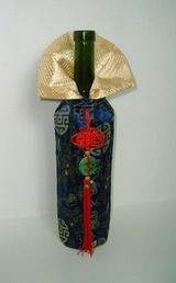 Traditional Chinese cloth style wine carrier with decorations